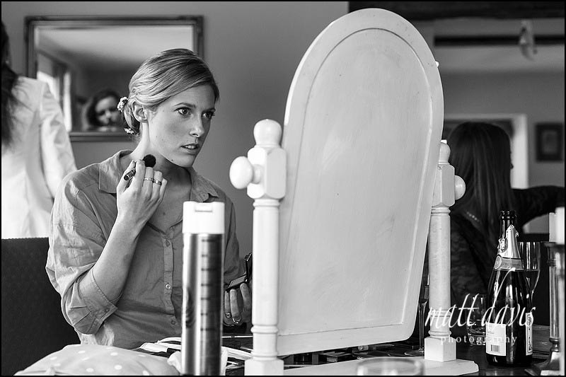 Stunning photo of bride doing wedding make-up