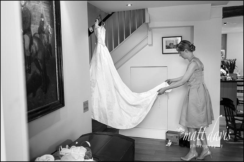 Wedding dress being carried to the brides bedroom
