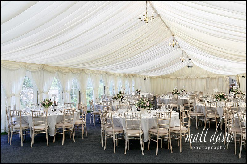 The inside of a wedding marquee set up at Hamswell House