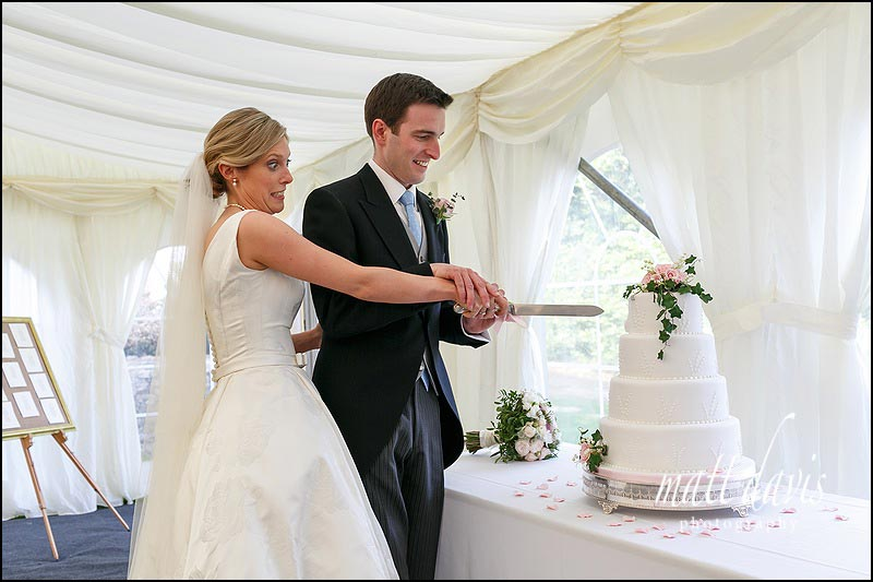 Wedding cake cutting in the Marquee at Hamswell House