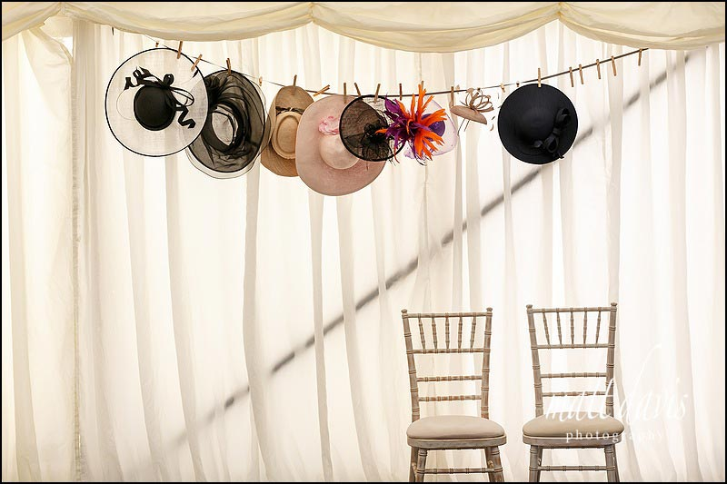 Wedding hats hanging in the Marquee at Hamswell House