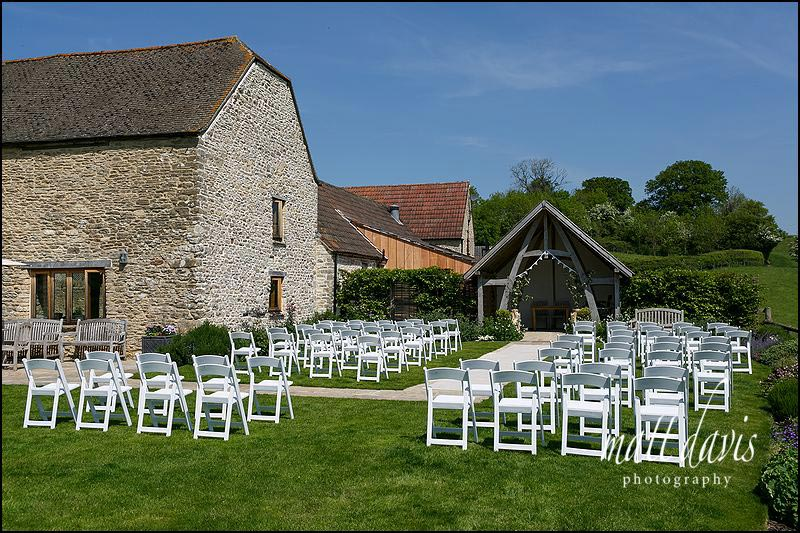 An outdoor wedding at Kingscote Barn