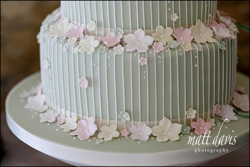 Amazingly detailed wedding cake with fine piping and sage green icing