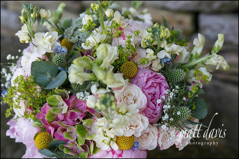 Mixed spring flowers in country style wedding bouquet