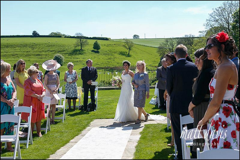 An outdoor civil wedding ceremony at Kingscote Barn