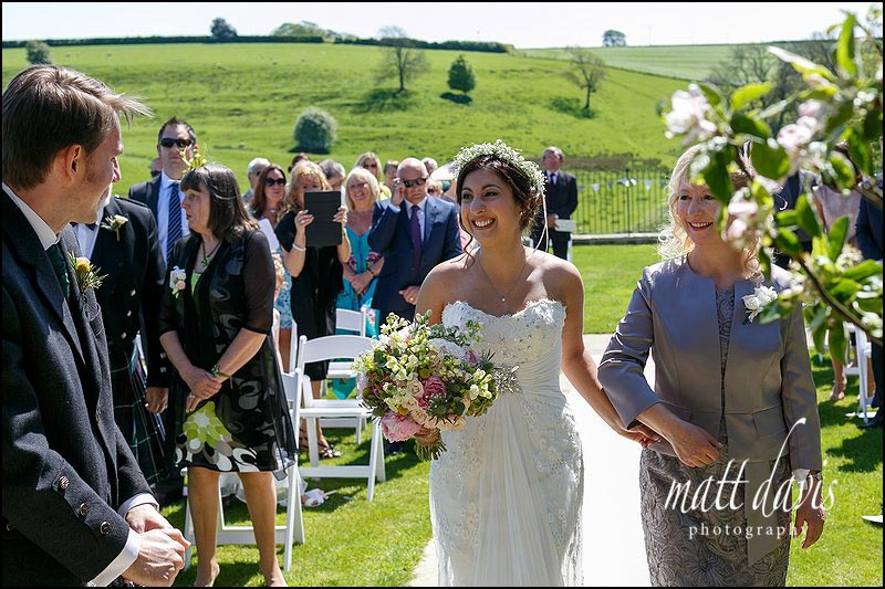 Relaxed wedding photos taken during an outdoor wedding at Kingscote Barn