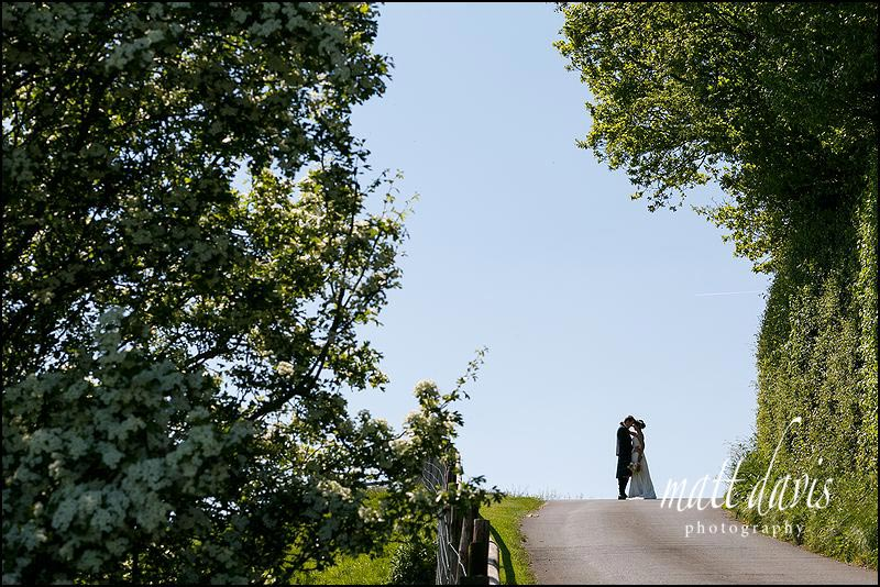 Artistic wedding couple portraits taken at Kingscote Barn by Matt Davis