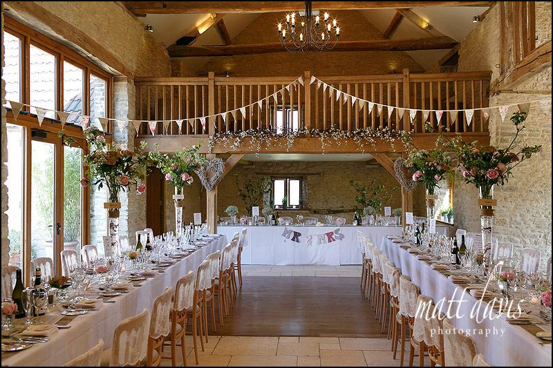 Long banquet style layout of tables at Kingscote Barn