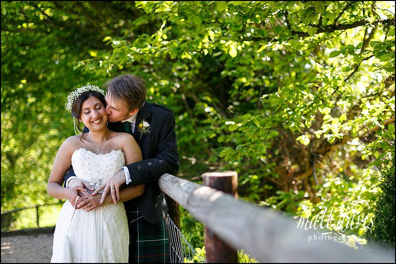 Relaxed couple portraits taken during an outdoor wedding at Kingscote Barn