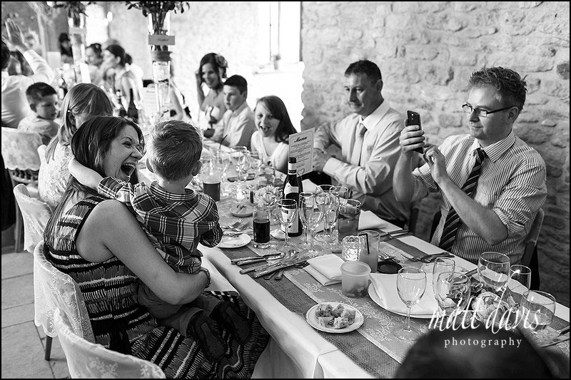 Candid photos taken by documentary wedding photographer Matt Davis at Kingscote Barn