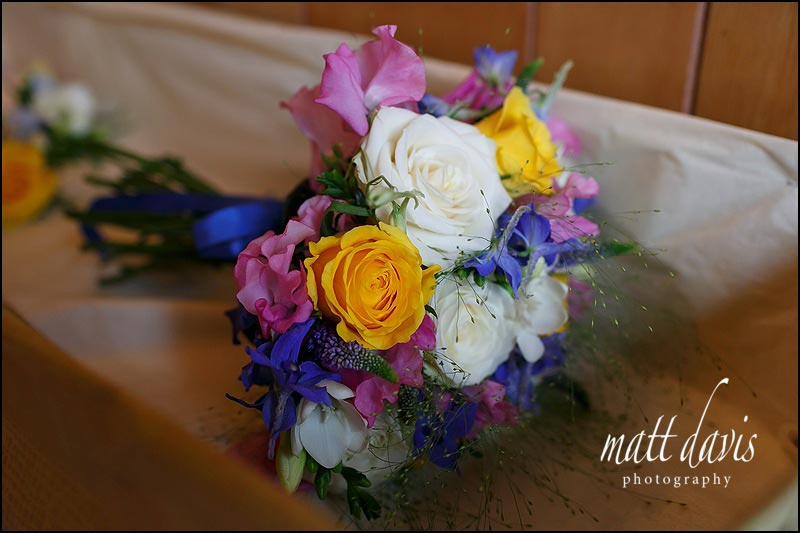 Medium size, bright wedding bouquet, simply tied with blue ribbon.