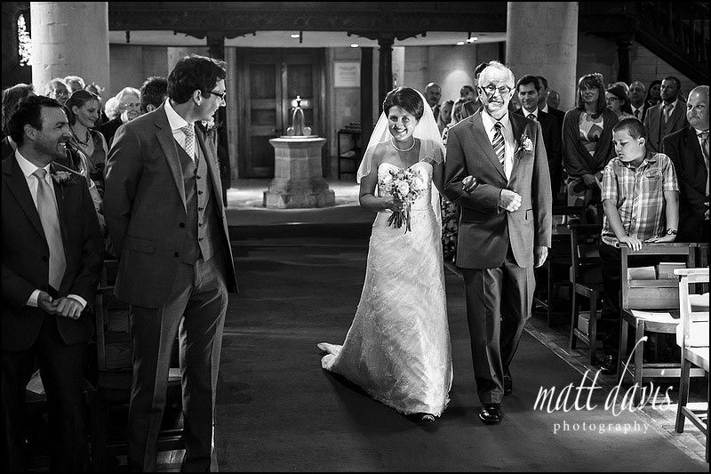 bride walking down the aisle at St Michael's & All Angels Church, Bishop's Cleeve, Cheltenham