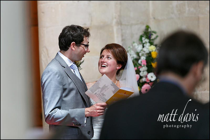 Wedding couple singing at St Michael's & All Angels Church, Bishop's Cleeve, Cheltenham