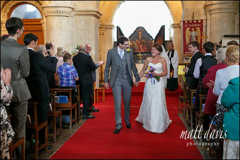 Wedding couple exiting St Michael's & All Angels Church, Bishop's Cleeve, Cheltenham