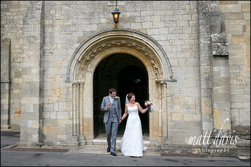 Wedding couple leaving St Michael's & All Angels Church, Bishop's Cleeve, Cheltenham