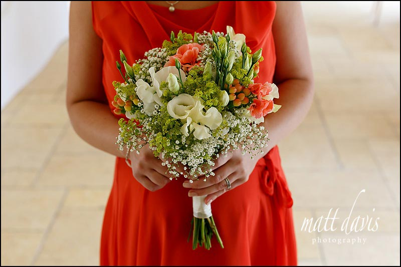 Orange bridesmaid dresses and bouquet to match