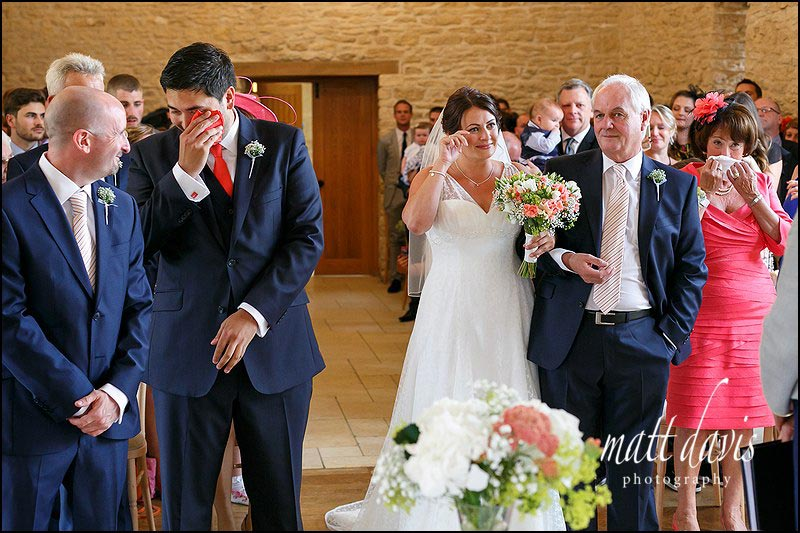 Bride and groom with tears during their wedding ceremony at Kingscote Barn