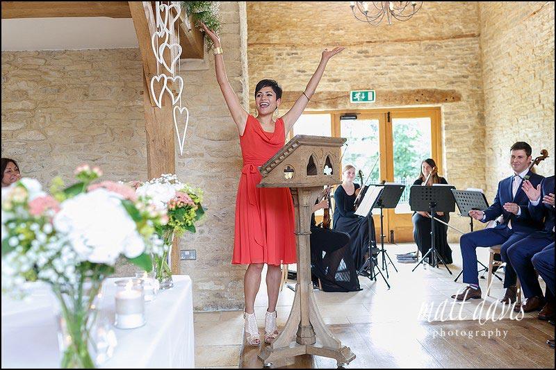 Photographer capturing real moments during a summer wedding at Kingscote Barn