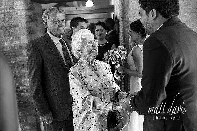 Black and white documentary wedding photography at Kingscote Barn by Matt Davis