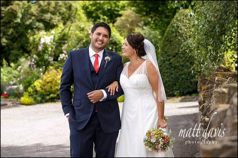 Relaxed natural wedding portraits taken during a summer wedding at Kingscote Barn