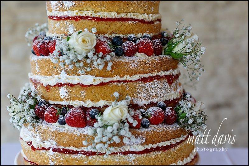Summer wedding cake at Kingscote Barn