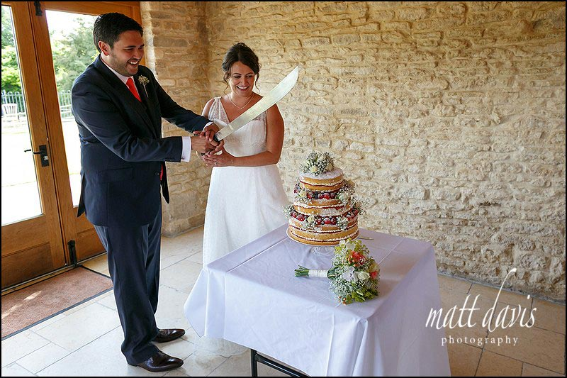 A summer wedding cake at Kingscote Barn