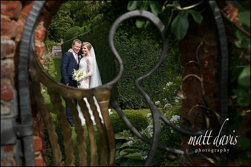 Wedding photo including the Angel Gate at Birtsmorton Court