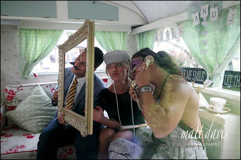 Wedding guests in the photo booth at Birtsmorton Court