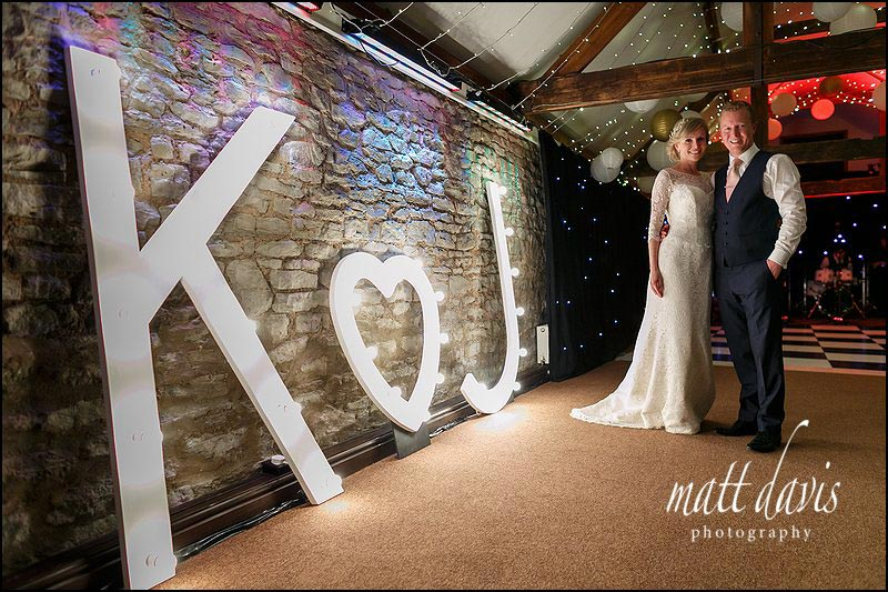 Oversize letters lit up with wedding couples initials.