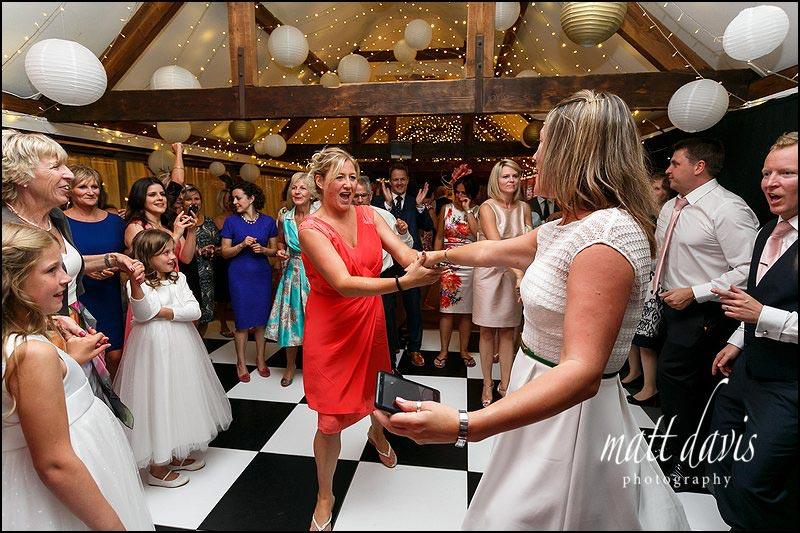 Wedding guests having fun on the dance floor at Birtsmorton Court