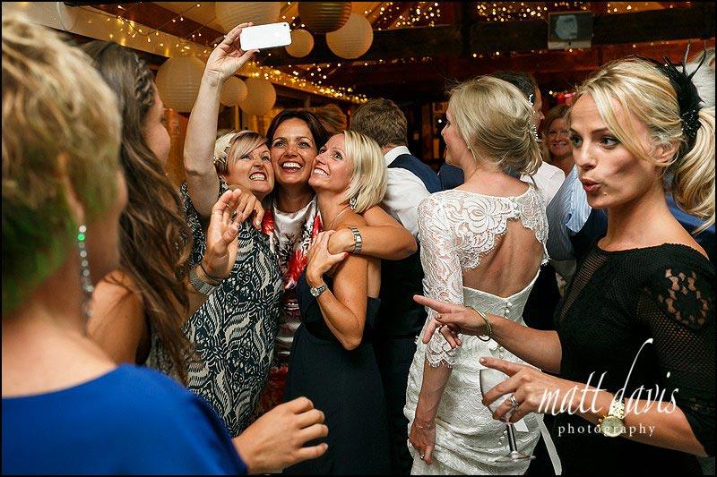 Wedding guest selfie on the dance floor at Birtsmorton Court