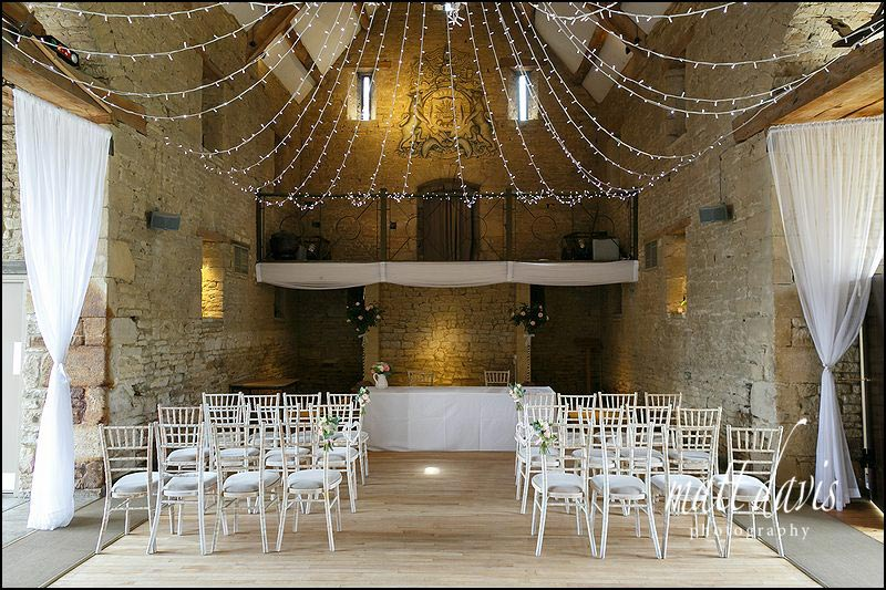 inside the Great Tythe Barn with fairy lights