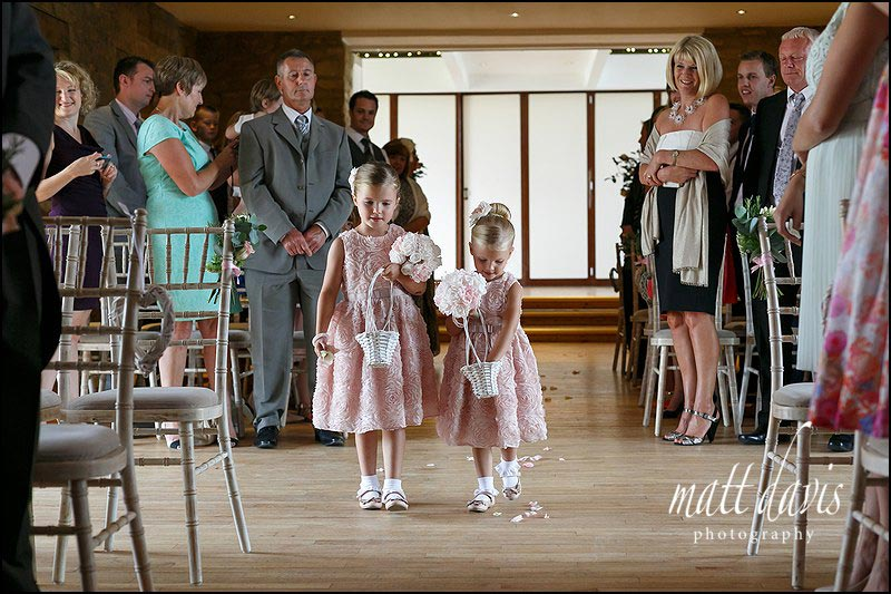 Flower girls at a wedding at The Great Tythe Barn, Tetbury, Gloucestershire