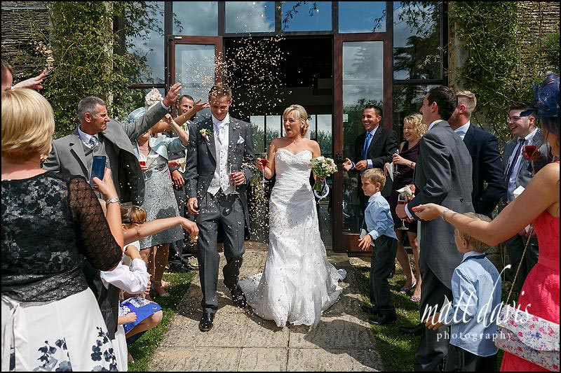 Confetti throwing at the Great Tythe Barn, Tetbury, Gloucestershire