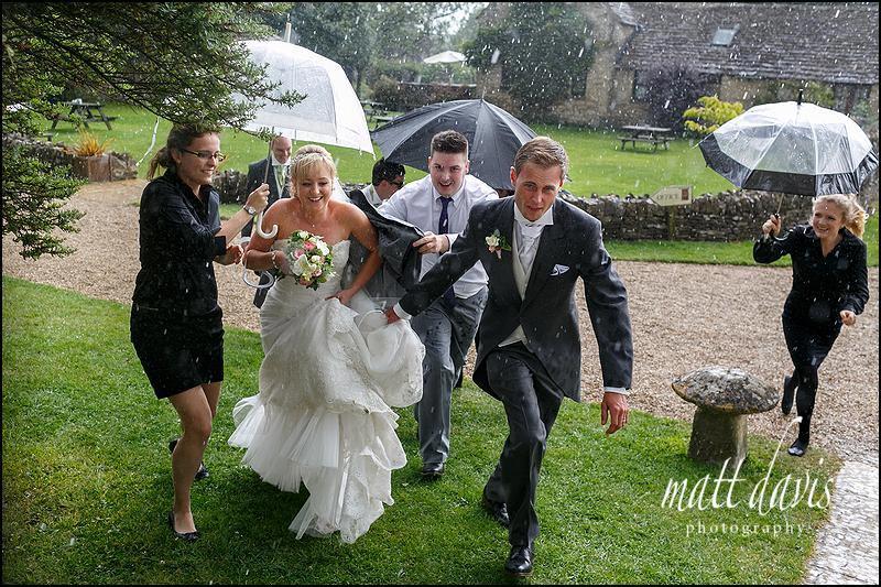 Great Tythe Barn wedding photos in the rain