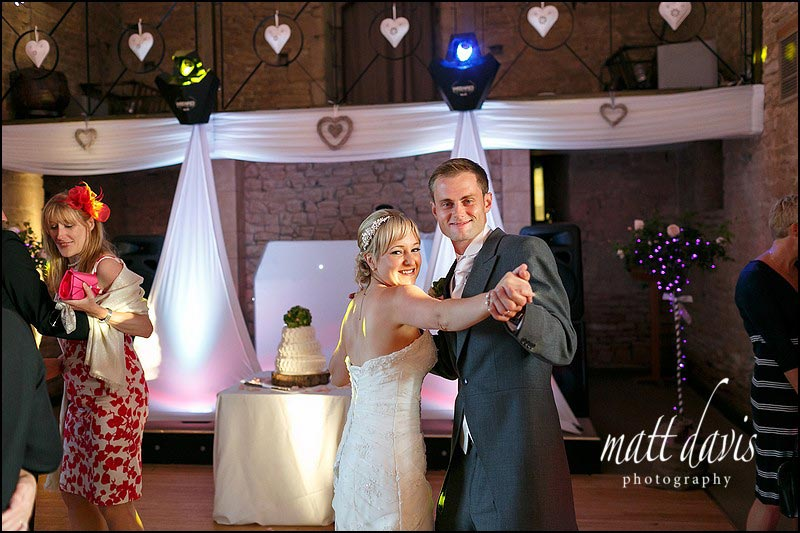 First dance wedding photos at The Great Tythe Barn, Tetbury.