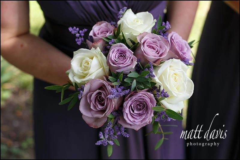 Purple and cream roses in bridesmaids bouquet