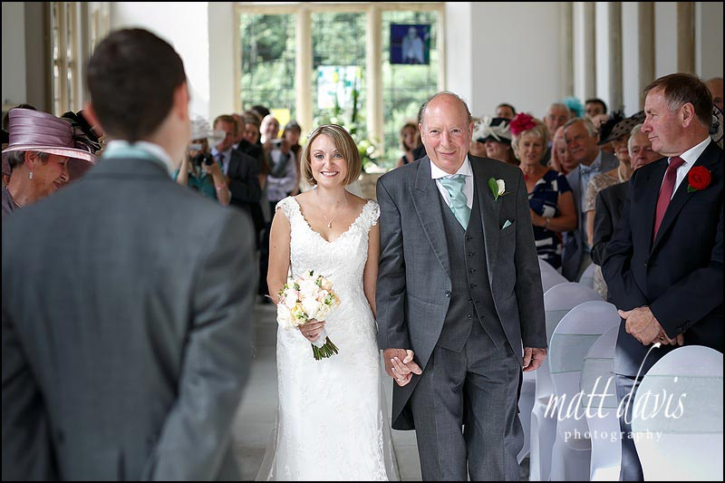 Brides walking down the aisle at Highcliffe castle for a wedding