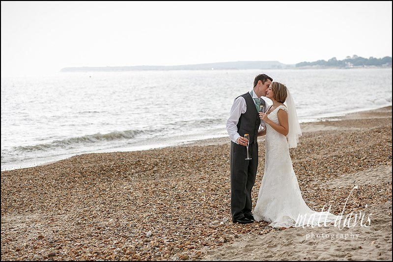 romantic wedding photos on the beach at Highcliffe castle, Christchurch
