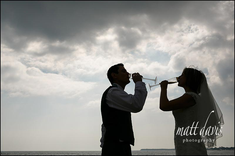 unusual wedding photos on the beach at Highcliffe castle, Christchurch