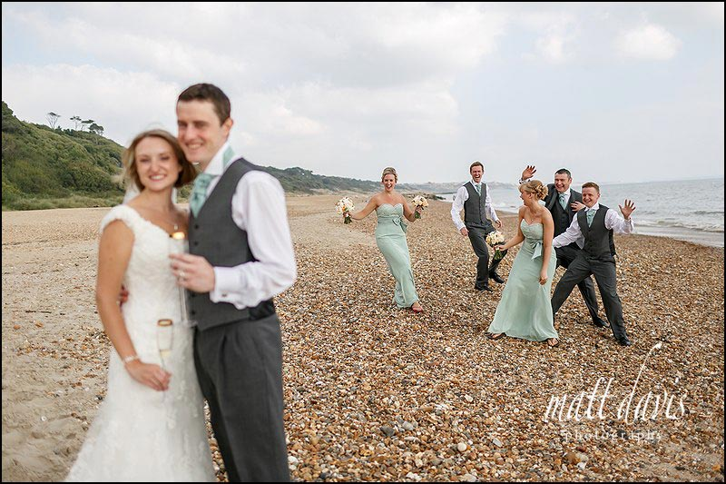 fun wedding photos on the beach at Highcliffe castle, Christchurch