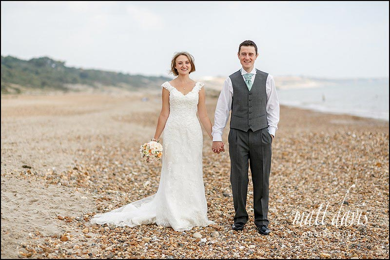 classic wedding photos on the beach at Highcliffe castle, Christchurch