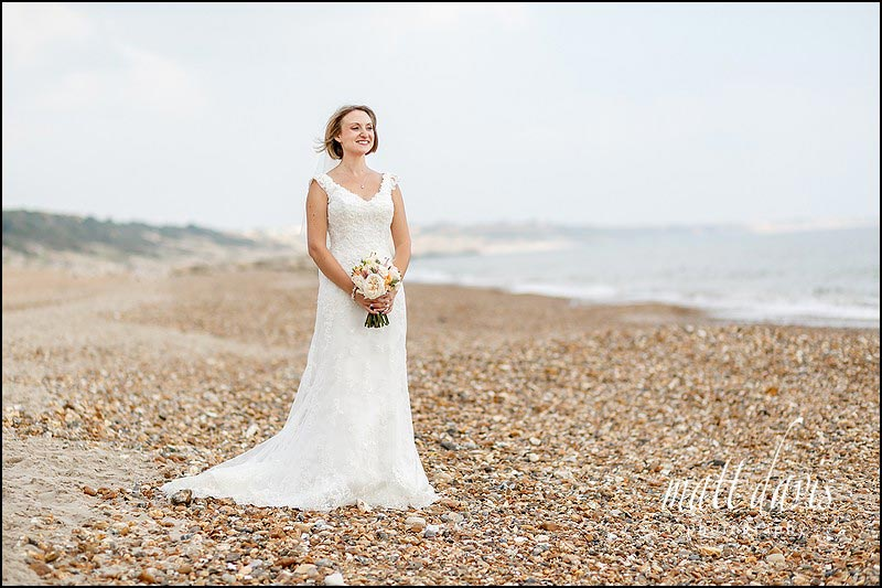 stunning wedding photos on the beach at Highcliffe castle, Christchurch