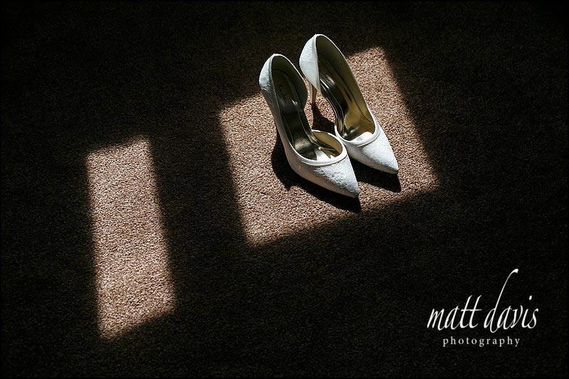 wedding shoes photo taken at Kingscote Barn