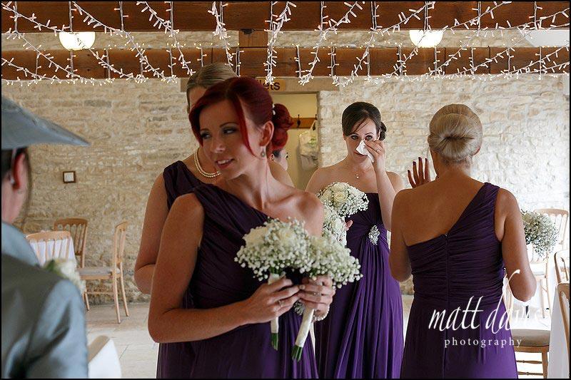 Emotional wedding photos at Kingscote Barn