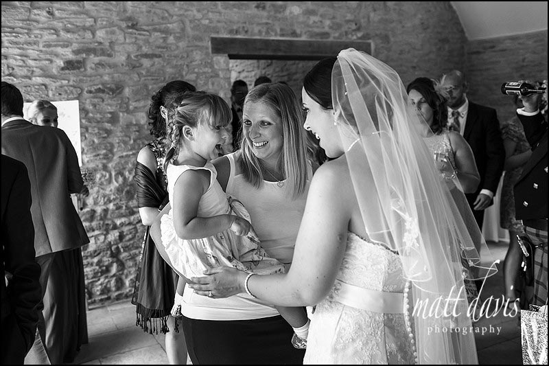 Black and white documentary wedding photography at Kingscote Barn