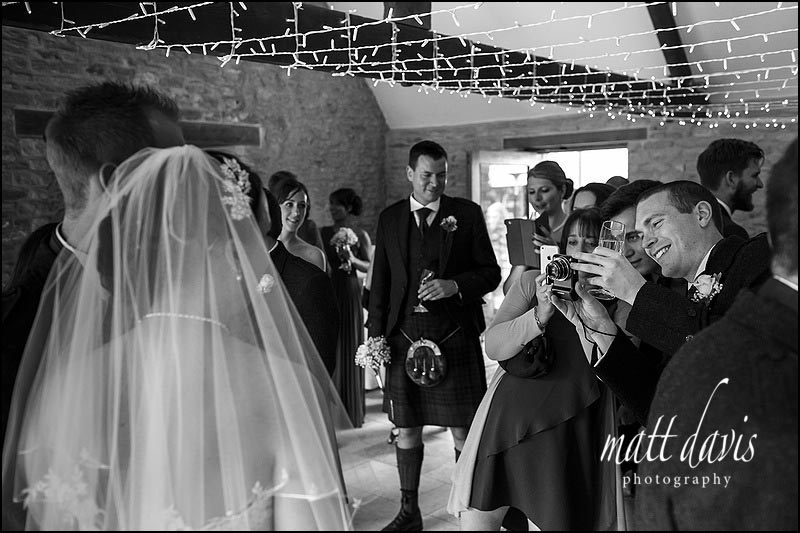 Black and white documentary wedding photos at Kingscote Barn