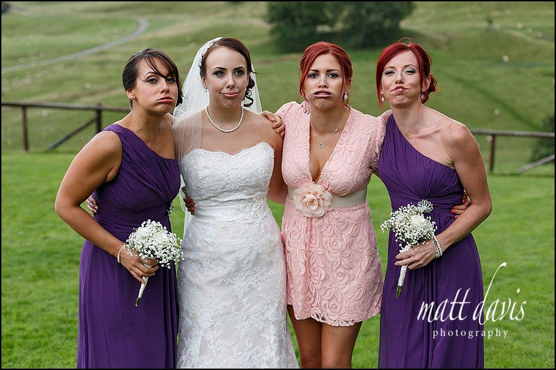 Silly faces for group photos at a wedding at Kingscote Barn