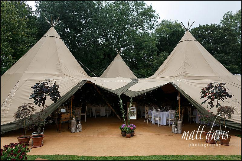 A quintessentially English wedding with teepee marquees Oxfordshire