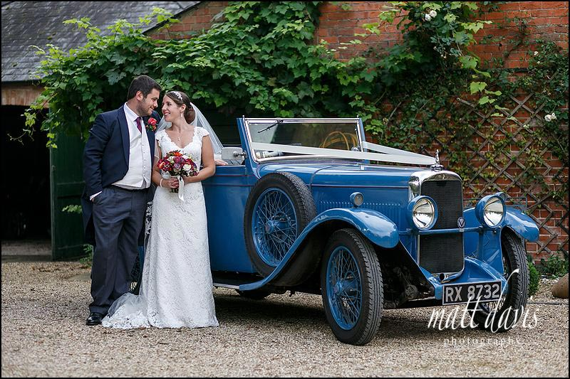 Wedding photo including a classic vintage wedding car